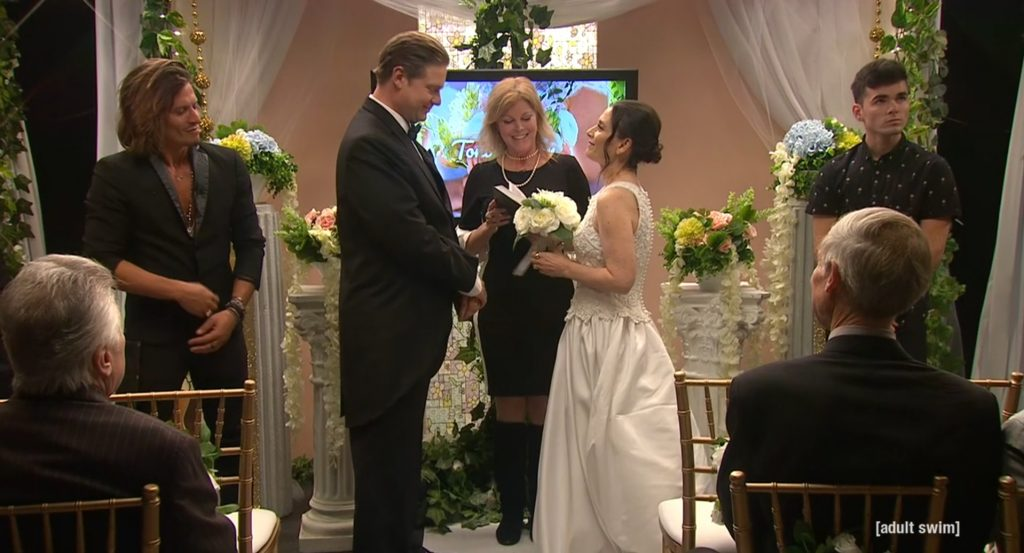 The pastor performs Tim and Toni's marriage ceremony